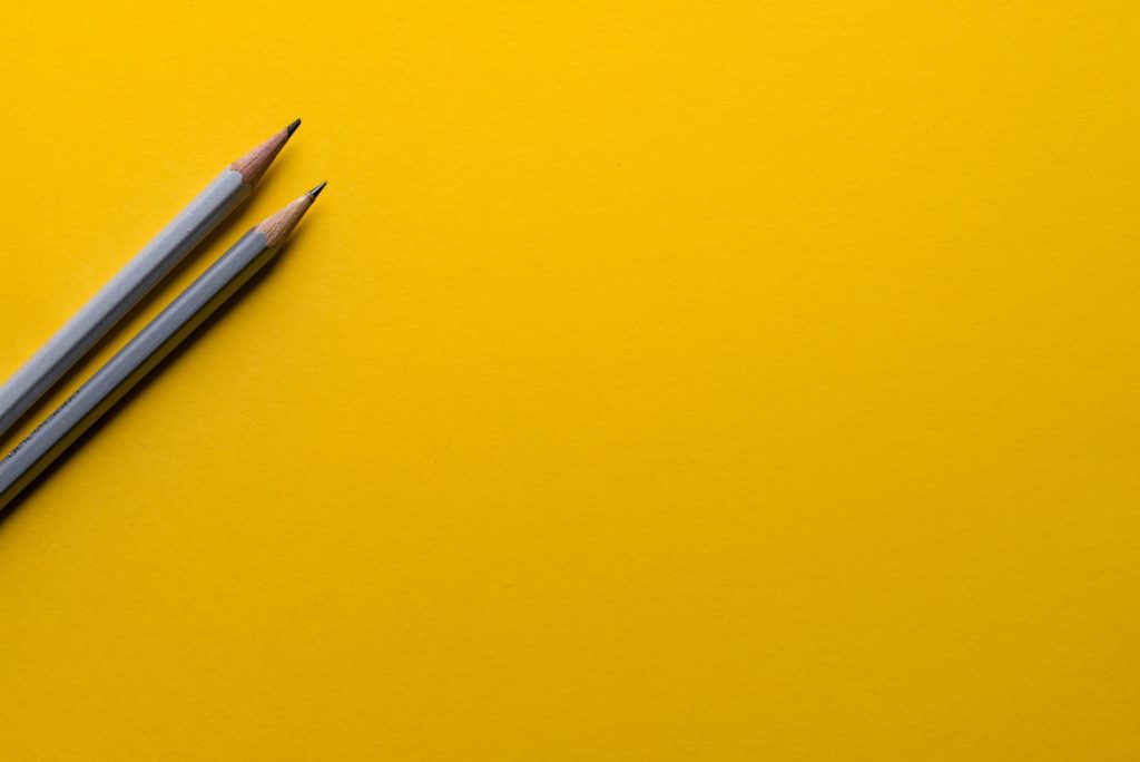 yellow paper sheet and pencils